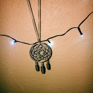 Gold dream catch necklace